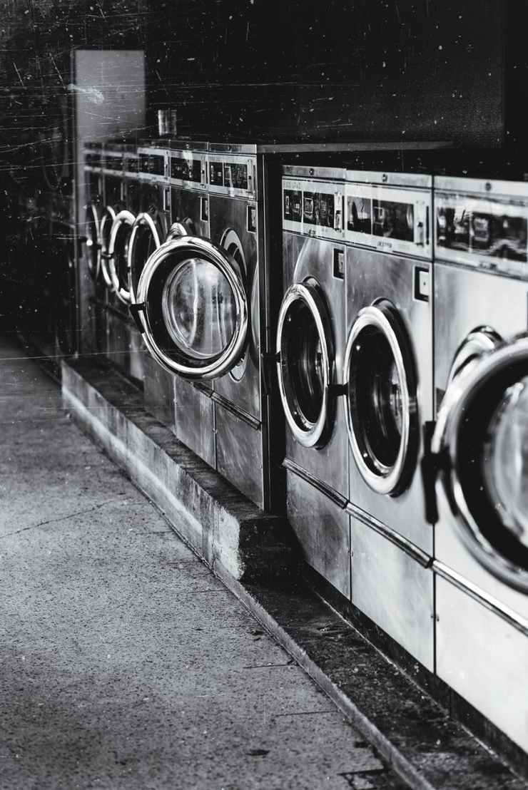 grayscale photography of front load washers